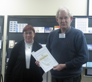 Robert Duns with with his certificate presented by Karen Jeffrey, South Island NZPF delegate at the August meeting of the Christchurch Philatelic Society.
