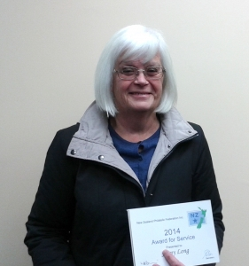Jenny Long with her award presented by Karen Jeffrey, South Island federation delegate at the July postcard meeting of the Christchurch Philatelic Society