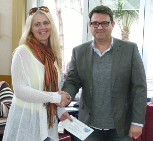 Andrea Bevan receiving her award from NZPF President, Mark Benvie.
