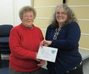 Sue vernall being presented with her award by Leigh Gravestock, Central Region delegate.