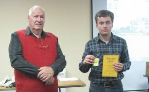 Warrick with his PYC Gold Achievement Award presented by Geoff Tyson, PYC Vice-Chairperson.
