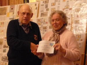 Mike being presented with his award by Barbara Streeter.