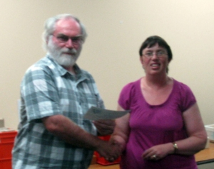 Graham receiving his award from Karen Jeffrey Southern Region delegate.