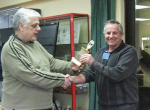 Steven McLachlan presenting inter-club trophy to Bruce Tapp of Waikato Philatelic Society.