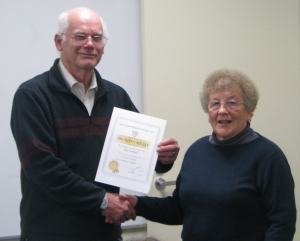 Sue receiving her award from Bob Gibson, Federation secretary