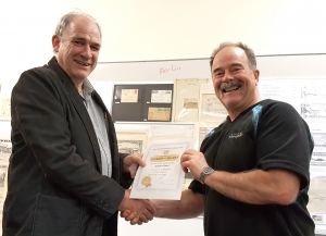 Stephen Jones receiving his award from NZPF President Stephen Chivers.