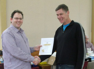 David Loe receiving his award from Tim Beach, NZPF Northern Region delegate.